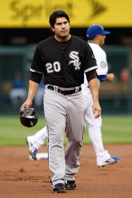 KANSAS CITY - MAY 5:  Carlos Quentin #20 of the Chicago White Sox walks off the field during the game against the Kansas City Royals on May 5, 2009 at Kauffman Stadium in Kansas City, Missouri. (Photo by: Jamie Squire/Getty Images)
