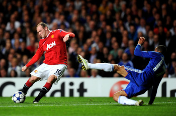 LONDON, ENGLAND - APRIL 06:  Wayne Rooney of Manchester United takes a shot on goal as Jose Bosingwa of Chelsea closes in during the UEFA Champions League quarter final first leg match between Chelsea and Manchester United at Stamford Bridge on April 6, 2