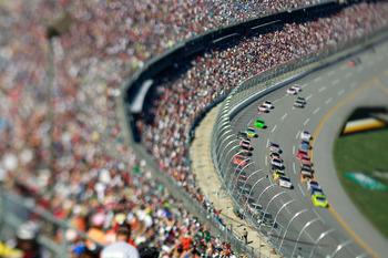 TALLADEGA, AL - OCTOBER 31:  (***EDITORS NOTE*** - THIS DIGITAL IMAGE WAS CREATED WITH THE USE OF VARIABLE FOCAL PLANE LENS) Cars race through the tri-oval during the NASCAR Sprint Cup Series AMP Energy Juice 500 at Talladega Superspeedway on October 31,