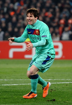 DONETSK, UKRAINE - APRIL 12:  Lionel Messi of Barcelona celebrates scoring the opening goal during the UEFA Champions League Quarter Final 2nd Leg match between Shakhtar Donetsk and Barcelona, at the Donbass Arena on April 12, 2011 in Donetsk, Ukraine.  (