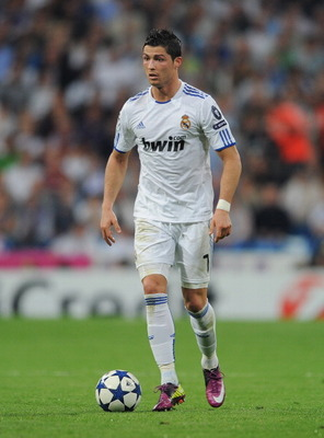 MADRID, SPAIN - APRIL 05:  Cristiano Ronaldo of Real Madrid controls the ball during the UEFA Champions League quarter final first leg match between Real Madrid and Tottenham Hotspur at Estadio Santiago Bernabeu on April 5, 2011 in Madrid, Spain.  (Photo