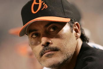 BALTIMORE - AUGUST 12:  Rafael Palmeiro #25 of the Baltimore Orioles watches from the dugout as his team plays against the Toronto Blue Jays August 12, 2005 at Oriole Park at Camden Yards in Baltimore, Maryland. Palmeiro was named in the Mitchell Report t