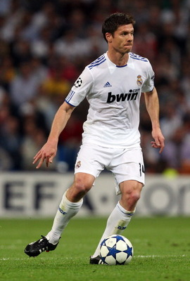 MADRID, SPAIN - APRIL 05:  Xabi Alonso of Real Madrid during the UEFA Champions League Quarter Final first leg match between Real Madrid and Tottenham Hotspur at Estadio Santiago Bernabeu on April 5, 2011 in Madrid, Spain.  (Photo by Clive Rose/Getty Imag