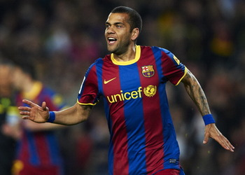 BARCELONA, SPAIN - MARCH 19:  Daniel Alves of Barcelona celebrates after scoring during the La Liga match between Barcelona and Getafe at Camp Nou on March 19, 2011 in Barcelona, Spain. Barcelona won 2-1. (Photo by Manuel Queimadelos Alonso/Getty Images)