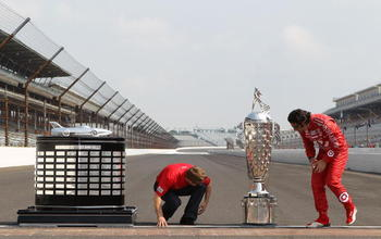 INDIANAPOLIS - MAY 31:  (R-L)  Dario Franchitti of Scotland, driver of the #10 Target Chip Ganassi Racing Dallara Honda and Chip Ganassi Racing Nascar driver and 2010 Daytona 500 winner Jamie McMurray with the Harley J. Earl trophy and the Borg Warner tro