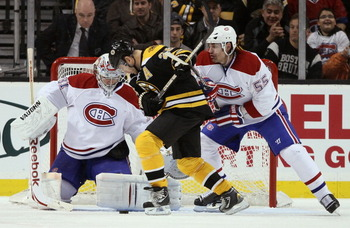 BOSTON, MA - MARCH 24:  Mark Recchi #28 of the Boston Bruins tries to take a shot as Brent Sopel #55 and Carey Price #31 of the Montreal Canadiens defend on March 24, 2011 at the TD Garden in Boston, Massachusetts.  (Photo by Elsa/Getty Images)