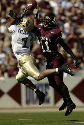 COLLEGE STATION, TX - SEPTEMBER 27:  Wide receiver Larry Fitzgerald #1 of the University of Pittsburgh Panthers nearly catches a pass near defensive back Byron Jones #11 of the Texas A&M University Aggies at Kyle Field on September 27, 2003 in College Sta