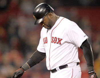 BOSTON, MA - APRIL 11:  David Ortiz #34 of the Boston Red Sox reacts after making an out in the ninth inning against the Tampa Bay Rays at Fenway Park April 11, 2011 in Boston, Massachusetts. (Photo by Jim Rogash/Getty Images)