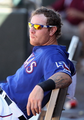 SURPRISE, AZ - MARCH 11:  Josh Hamilton #32 of the Texas Rangers sits in the dugout during the spring training game against the Cincinnati Reds at Surprise Stadium on March 11, 2011 in Surprise, Arizona.  (Photo by Christian Petersen/Getty Images)