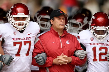 PALO ALTO, CA - OCTOBER 23:  Head coach Paul Wulff of the Washington State Cougars walks out of the tunnel with John Fullington #77 and Jeffrey Solomon #12 for their game against the Stanford Cardinal at Stanford Stadium on October 23, 2010 in Palo Alto,