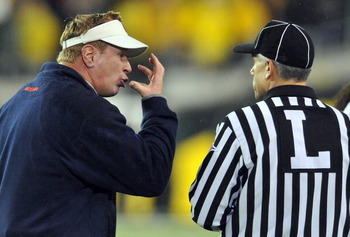 EUGENE, OR - NOVEMBER 26: Head coach Mike Stoops of the Arizona Wildcats has some words with head linesman Cappy Anderson in the second quarter of the game against the Oregon Ducks at Autzen Stadium on November 26, 2010 in Eugene, Oregon.The Ducks won the
