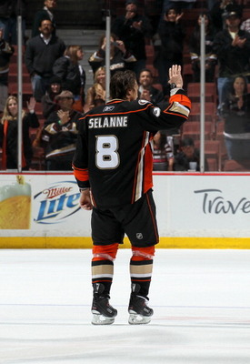 ANAHEIM, CA - APRIL 08:  Teemu Selanne #8 of the Anaheim Ducks waves as he skates after being named first star of the game against the Los Angeles King at Honda Center on April 8, 2011 in Anaheim, California. The Ducks won 2-1 to clinch a berth in the pla