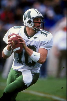31 Oct 1998:  Quarterback Chad Pennington #10 of the Marshall Thundering Herd drops back to pass during a game against the Bowling Green Falcons at Doyt L. Perry Field in Bowling Green, Ohio. The Falcons defeated the Thundering Herd 34-13. Mandatory Credi