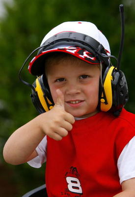 DARLINGTON, SC - MAY 13:  A young NASCAR fan gives the thumbs up, prior to the NASCAR Nextel Cup Series Dodge Avenger 500 on May 13, 2007 at Darlington Raceway in Darlington, South Carolina.   (Photo by Rusty Jarrett/Getty Images for NASCAR)