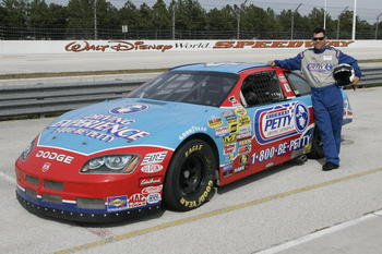 UNITED STATES - OCTOBER 17:  PGA TOUR player Phil Tataurangi poses outside of a Petty race car before members of the PGA TOUR take part in the Richard Petty Driving experience at the Walt Disney World Speedway on Tuesday October 17, 2006.  (Photo by Reinh