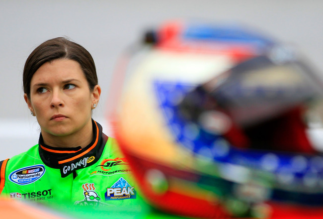 BRISTOL, TN - MARCH 18:  Danica Patrick, driver of the #7 GoDaddy.com Chevrolet, stands in the garage area during practice for the NASCAR Nationwide Series Scotts EZ Seed 300 at Bristol Motor Speedway on March 18, 2011 in Bristol, Tennessee.  (Photo by Ch