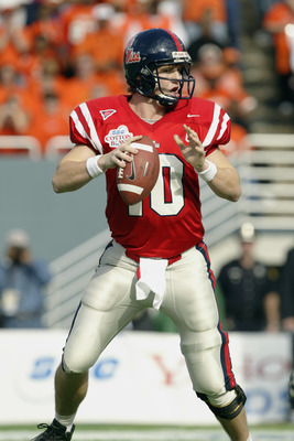 DALLAS - JANUARY 2:  Quarterback Eli Manning #10 of the Mississippi Rebels looks for the open receiver during the SBC Cotton Bowl against the Oklahoma State Cowboys on January 2, 2004 at the Cotton Bowl in Dallas, Texas.  'Ole Miss defeated Oklahoma State