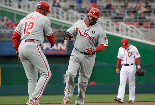 WASHINGTON, DC - APRIL 12:  Third base caoch Juan Samuel #12 congratulates Ryan Howard #6 of the Philadelphia Phillies after hitting a solo home run during the second inning against the Washington Nationals at Nationals Park on April 12, 2011 in Washingto