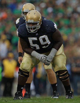 SOUTH BEND, IN - SEPTEMBER 25: Chris Stewart #59 of the Notre Dame Fighting Irish awaits the start of play against the Stanford Cardinal at Notre Dame Stadium on September 25, 2010 in South Bend, Indiana. Stanford defeated Notre Dame 37-14. (Photo by Jona