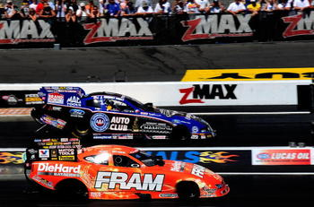 CONCORD, NC - SEPTEMBER 19:  Matt Hagan, drives the Fram Funny Car against Robert Hight, driver of the Auto Club Funny Car during the O'Reilly Auto Parts NHRA Nationals at zMax Dragway on September 19, 2010 in Concord, North Carolina.  (Photo by Rusty Jar