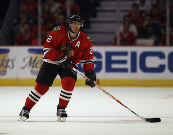 CHICAGO, IL - APRIL 10: Duncan Keith #2 of the Chicago Blackhawks controls the puck against the Detroit Red Wings at the United Center on April 10, 2011 in Chicago, Illinois. The Red Wings defeated the Blackhawks 4-3. (Photo by Jonathan Daniel/Getty Image