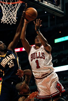 CHICAGO - FEBRUARY 24: Derrick Rose #1 of the Chicago Bulls goes up for a shot against Roy Hibbert #55 and Dahntay Jones #1 of the Indiana Pacers at the United Center on February 24, 2010 in Chicago, Illinois. The Bulls defeated the Pacers 120-110. NOTE T