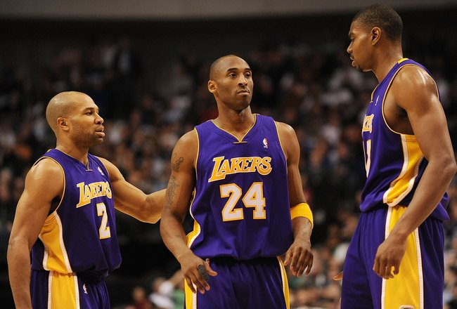 DALLAS - JANUARY 13:  Derek Fisher #1, Kobe Bryant #24 and Andrew Bynum #17 of the Los Angeles Lakers on January 13, 2010 at American Airlines Center in Dallas, Texas.  NOTE TO USER: User expressly acknowledges and agrees that, by downloading and/or using