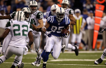 INDIANAPOLIS, IN - JANUARY 08:  Pierre Garcon #85 of the Indianapolis Colts runs for yards after the catch against the New York Jets during their 2011 AFC wild card playoff game at Lucas Oil Stadium on January 8, 2011 in Indianapolis, Indiana. The Jets wo