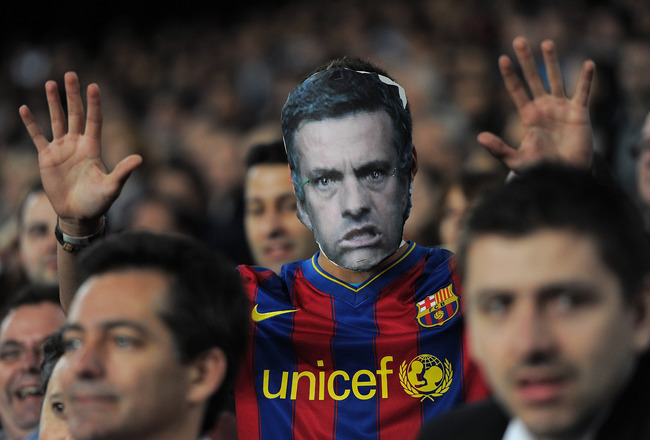 BARCELONA, SPAIN - APRIL 06:  A Barcelona fan with a cardboard mask of Real Madrid head coach Jose Mourinho follows the UEFA Champions League quarter final first leg match between Barcelona and Shakhtar Donetsk at the Camp Nou stadium on April 6, 2011 in