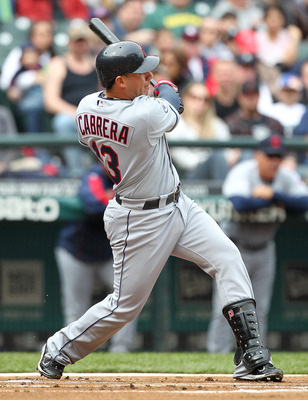 SEATTLE - APRIL 10:  Asdrubal Cabrera #13 of the Cleveland Indians watches his solo home run in the first inning against the Seattle Mariners at Safeco Field on April 10, 2011 in Seattle, Washington. The Indians defeated the Mariners 6-4. (Photo by Otto G