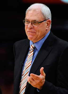 LOS ANGELES, CA - APRIL 03:  Coach Phil Jackson of the Los Angeles Lakers argues a call by referee Ron Garretson during the game against Denver Nuggets at Staples Center on April 3, 2011 in Los Angeles, California. NOTE TO USER: User expressly acknowledge