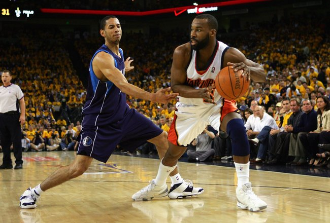 OAKLAND, CA - MAY 3:  Baron Davis #5 of the Golden State Warriors moves the ball against Devin Harris #34 of the Dallas Mavericks in Game Six of the Western Conference Quarterfinals during the 2007 NBA Playoffs on May 3, 2007 at Oracle Arena in Oakland, C