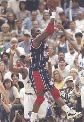 21 May 1997:  Center Hakeem Olajuwon of the Houston Rockets shoots the ball over forward Antoine Carr of the Utah Jazz during  playoff game at the Delta Center in Salt Lake City, Utah.  The Jazz won the game 104-92. Mandatory Credit: Brian Bahr  /Allsport