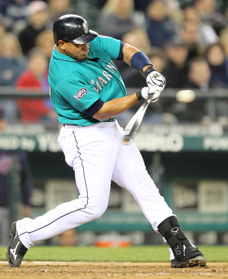SEATTLE, WA - APRIL 08:  Miguel Olivo #30 of the Seattle Mariners bats against the Cleveland Indians during the Mariners' home opener at Safeco Field on April 8, 2011 in Seattle, Washington. (Photo by Otto Greule Jr/Getty Images)