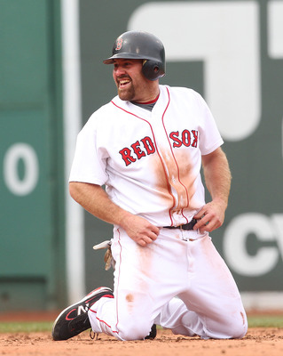 BOSTON, MA - APRIL 8:   Kevin Youkilis #20 of the Boston Red Sox smiles after being tagged out in a run down against the New York Yankees on Opening Day at Fenway Park on April 8, 2011 in Boston, Massachusetts. (Photo by Jim Rogash/Getty Images)