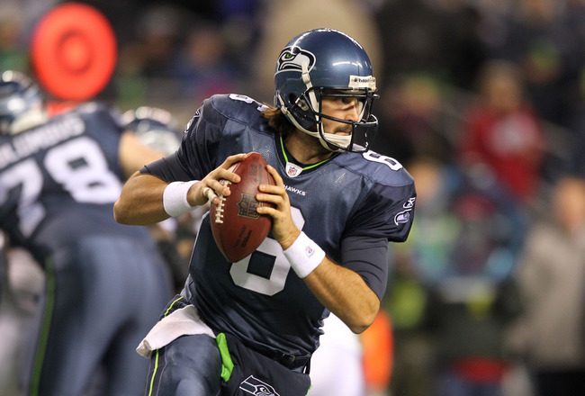 SEATTLE, WA - JANUARY 02:  Quarterback Charlie Whitehurst #6 of the Seattle Seahawks looks to pass during their game against the St. Louis Rams at Qwest Field on January 2, 2011 in Seattle, Washington.  (Photo by Otto Greule Jr/Getty Images)