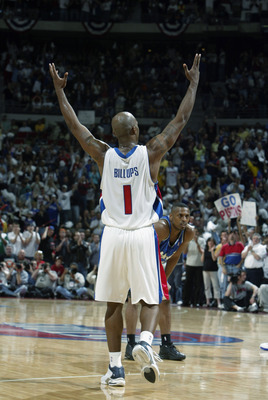 AUBURN HILLS, MI - MAY 4:  Chauncey Billups #1 of the Detroit Pistons raises his arms in celebration in Game seven of the Eastern Conference Quarterfinals against the Orlando Magic during the 2003 NBA Playoffs at The Palace of Auburn Hills on May 4, 2003