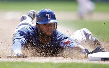 DETROIT, MI - APRIL 12:  Elvis Andrus #1 of the Texas Rangers steals third base in the sixth inning while playing the Detroit Tigers at Comerica Park on April 12, 2011 in Detroit, Michigan. Detroit won the game 5-4.  (Photo by Gregory Shamus/Getty Images)
