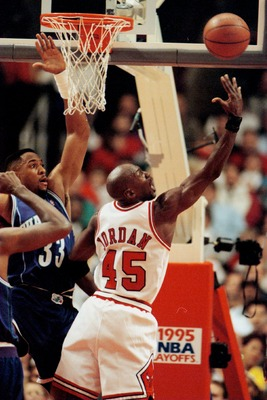 2 MAY 1995:  CHICAGO BULLS FORWARD MICHAEL JORDAN ATTEMPTS TO PUT A SHOT UP OVER CHARLOTTE HORNETS ALONZO MOURNING DURING FIRST HALF ACTION OF GAME THREE IN THE NBA FIRST ROUND PLAY-OFF ACTION BETWEEN THE TWO TEAMS AT THE UNITED CENTER IN CHICAGO, ILLINOI