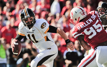 LINCOLN, NE - OCTOBER 30: Quarterback Blaine Gabbert #11 of the Missouri Tigers tries to avoid defensive end Pierre Allen #95 of the Nebraska Cornhuskers during first half action of their game at Memorial Stadium on October 30, 2010 in Lincoln, Nebraska.