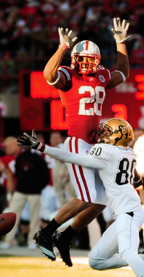 LINCOLN, NE - NOVEMBER 26: Eric Hagg #28 of the Nebraska Cornhuskers attempts to not interfere with Paul Richardson #80 of the Colorado Buffaloes during their game at Memorial Stadium on November 26, 2010 in Lincoln, Nebraska. Nebraska defeated Colorado 4