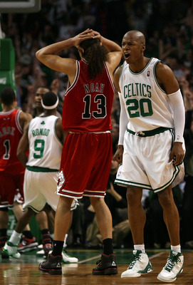 BOSTON - APRIL 20:  Ray Allen #20 of the Boston Celtics reacts after he sinks his last second game winning basket as Joakim Noah #13 of the Chicago Bulls reacts to the loss in Game Two of the Eastern Conference Quarterfinals during the 2009 NBA Playoffs a