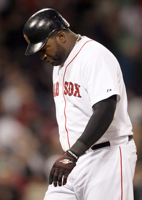 BOSTON, MA - APRIL 12:  David Ortiz #34 of the Boston Red Sox walks off the field after he hit a pop fly out to end the game against the Tampa Bay Rays on April 12, 2011 at Fenway Park in Boston, Massachusetts. The Tampa Bay Rays defeated the Boston Red S