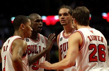 CHICAGO, IL - MARCH 25: (L-R) Derrick Rose #1, Loul Deng #9, Joakim Noah #13 and Kyle Korver #26 of the Chicago Bulls gather to talk during a game against the Memphis Grizzlies at the United Center on March 25, 2011 in Chicago, Illinois. The Bulls defeate