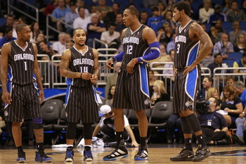 ORLANDO, FL - FEBRUARY 03: (L-R) Guard Gilbert Arenas #1, Guard Jameer Nelson #14, Center Dwight Howard #12 and Forward Earl Clark #3 of the Orlando Magic line against the Miami Heat at Amway Arena on February 3, 2011 in Orlando, Florida. NOTE TO USER: Us