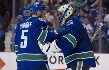 VANCOUVER, CANADA - MARCH 31: Goalie Roberto Luongo #1 of the Vancouver Canucks is congratulated by Christian Ehrhoff #5 after defeating the Los Angeles Kings in NHL action on March 31, 2011 at Rogers Arena in Vancouver, BC, Canada.  (Photo by Rich Lam/Ge