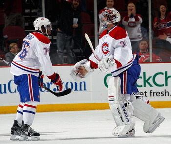 NEWARK, NJ - APRIL 02:  P.K. Subban #76 of the Montreal Canadians congratulates goalie Carey Price #31 on a win over the New Jersey Devils in an NHL hockey game at the Prudential Center on April 2, 2011 in Newark, New Jersey.  (Photo by Paul Bereswill/Get