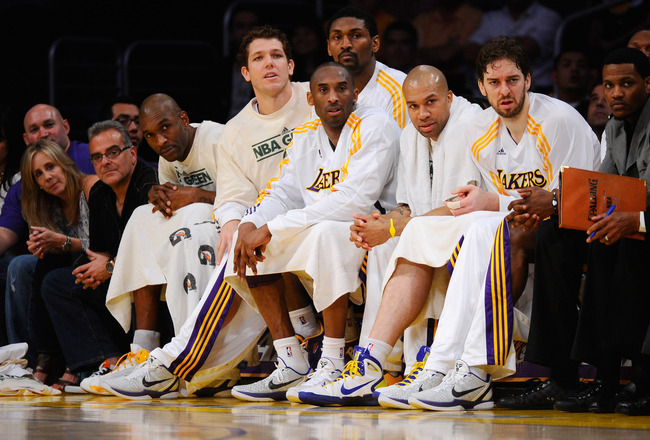 LOS ANGELES, CA - APRIL 03:  (L-R) Joe Smith #1, Luke Walton #4, Ron Artest #15, Kobe Bryant #24, Derek Fisher #2 and Pau Gasol #16 of the Los Angeles Lakers watch from the bench during the game against Denver Nuggets at Staples Center on April 3, 2011 in
