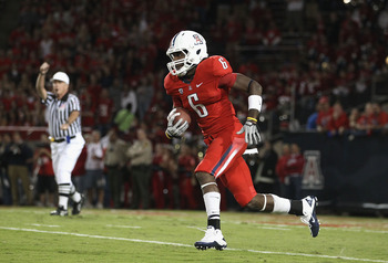 TUCSON, AZ - OCTOBER 23:  Travis Cobb #6 of the Arizona Wildcats runs with the ball during the college football game against the Washington Huskies at Arizona Stadium on October 23, 2010 in Tucson, Arizona.   The Wildcats defeated the Huskies 44-14.  (Pho