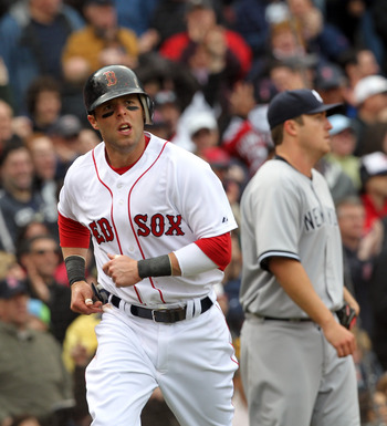 BOSTON, MA - APRIL 8:  Dustin Pedroia # 15 of the Boston Red Sox scores a run against Phil Hughes #65 of  the New York Yankees in the second  inning on Opening Day at Fenway Park on April 8, 2011 in Boston, Massachusetts. (Photo by Jim Rogash/Getty Images